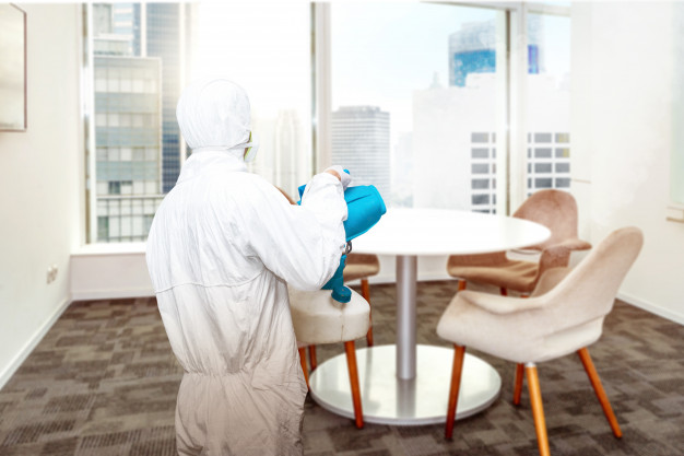 man white protective suit spraying disinfectant office room 9083 4318